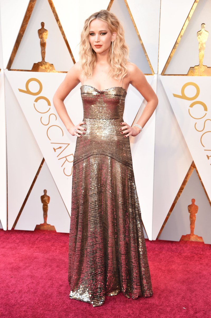 Jennifer Lawrence Wearing a shimmering bronze Dior gown.