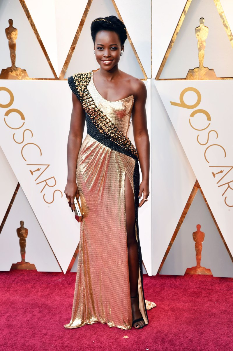 Lupita Nyong'o Wearing a gold and black Versace chainmail gown.