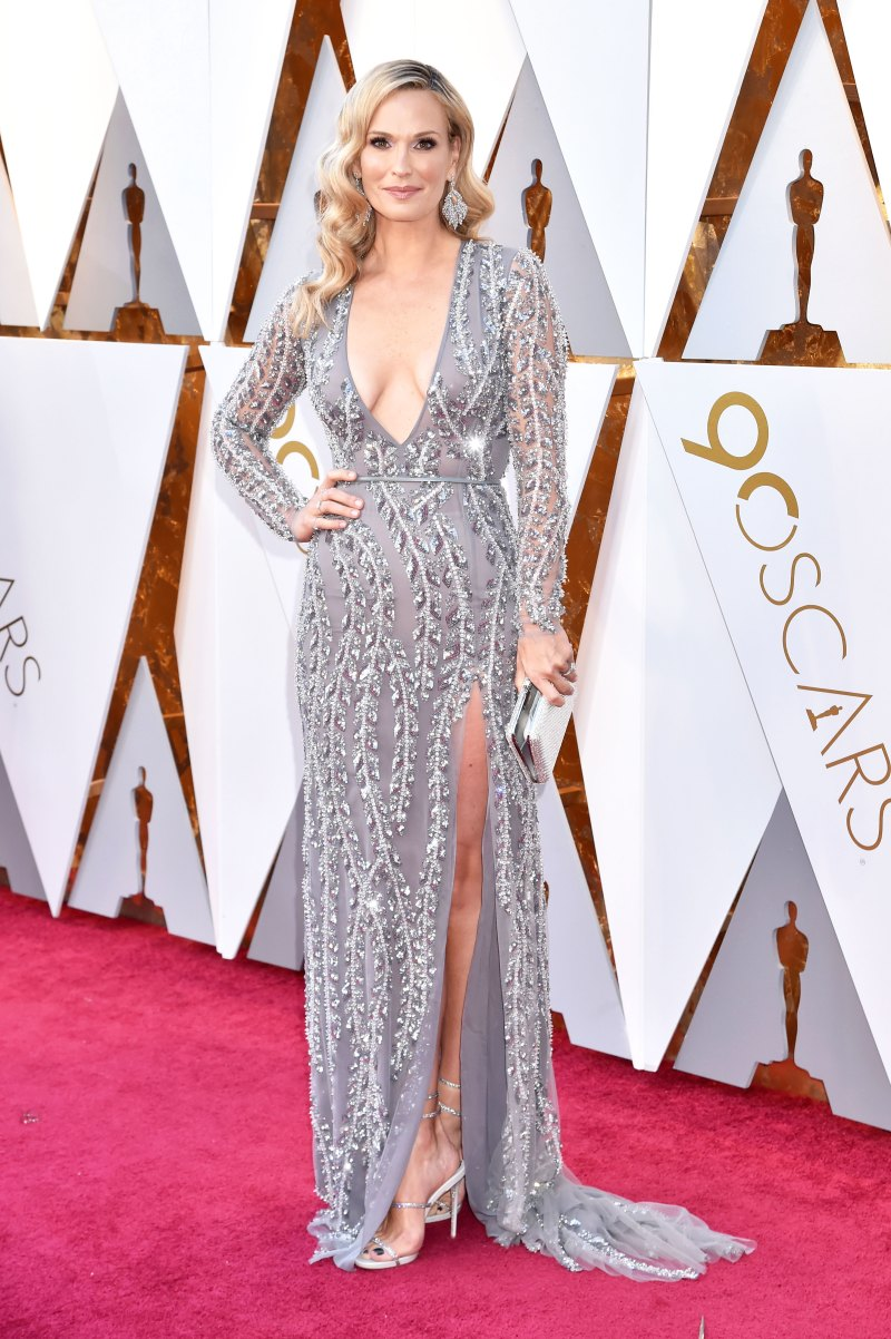 Molly Sims Wearing a beaded silver Naeem Khan gown and Renee Caovilla heels