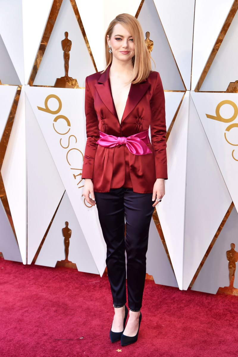 Emma Stone Wearing a red, pink and black custom Louis Vuitton suit.