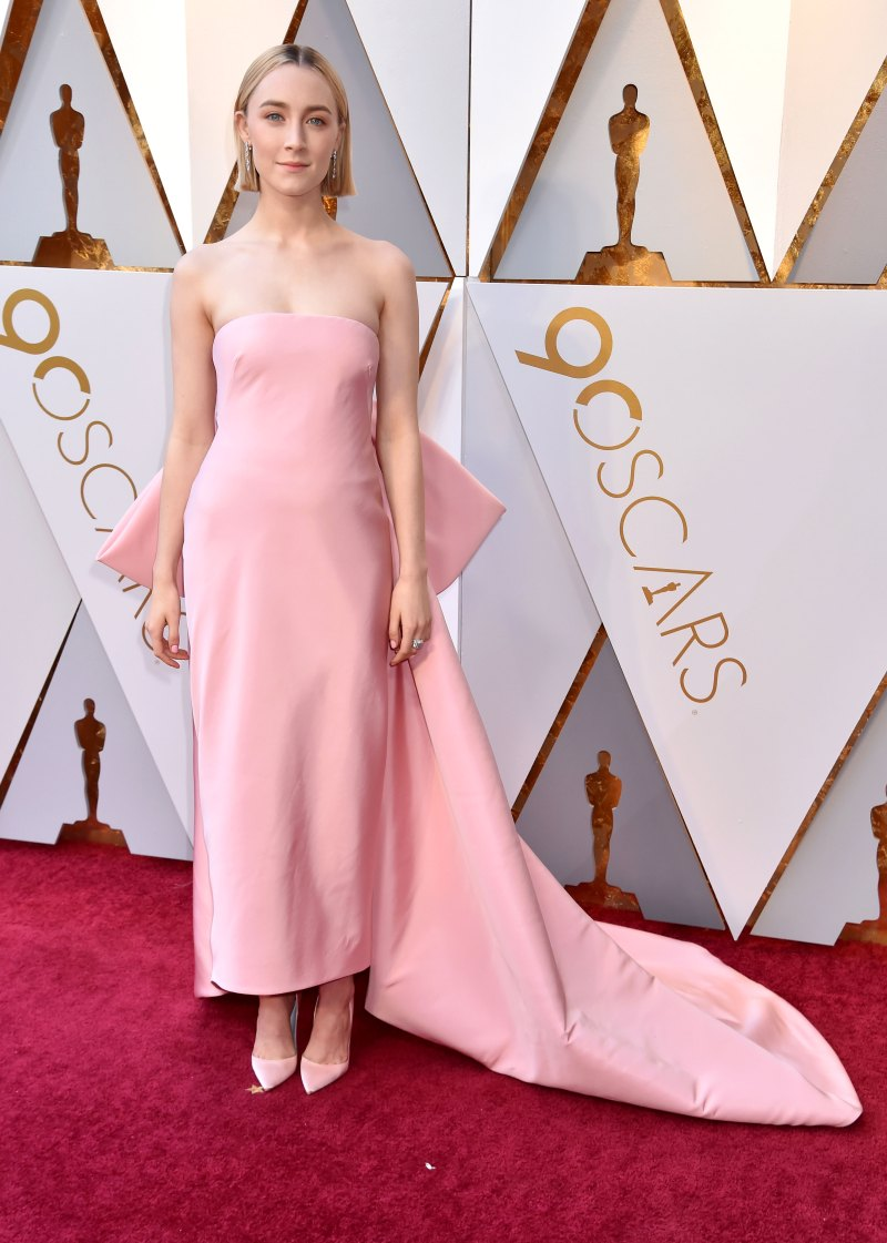 Saoirse Ronan Wearing strapless soft pink Calvin Klein By Appointment with an oversized bow and train and matching satin pumps.