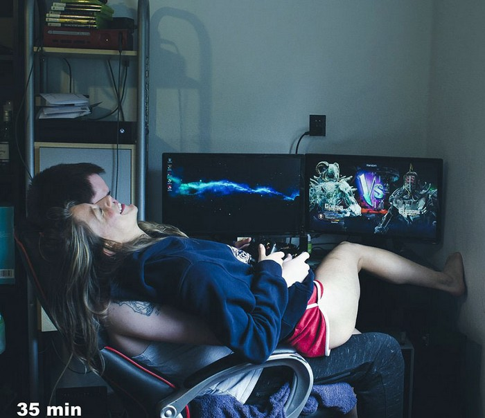Marie sitting on a man playing computer games