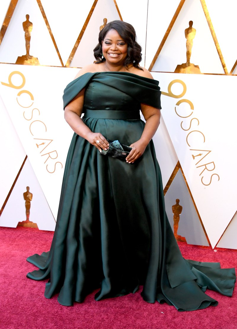 Octavia Spencer In an emerald of-the-shoulder satin gown and carrying a Tyler Ellis clutch