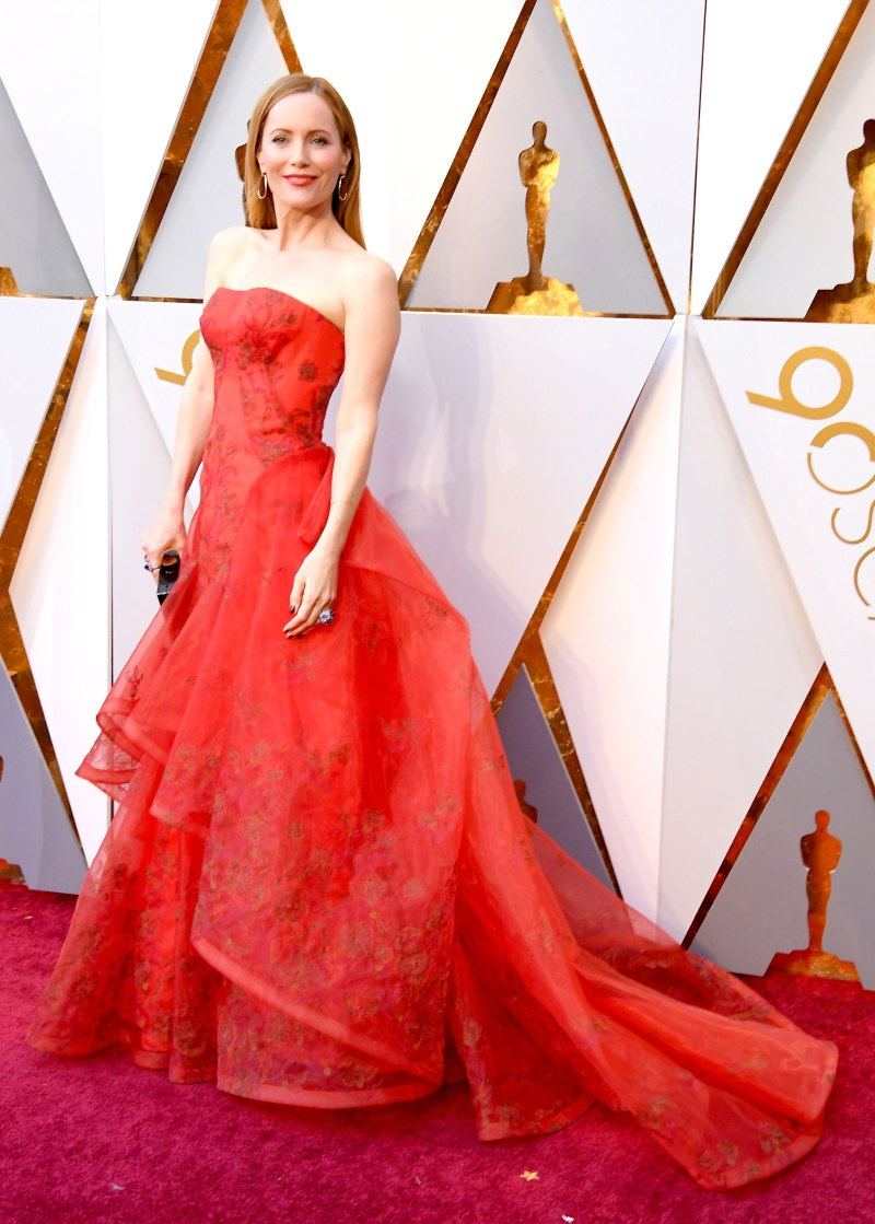 Leslie Mann Wearing a strapless red guipure lace gown with a full skirt and embellishment at the neckline by Zac Posen.