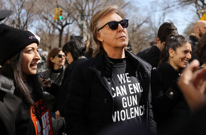 Paul McCartney marching in New York