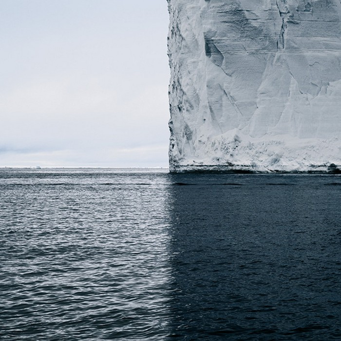 an iceberg reflecting on the water