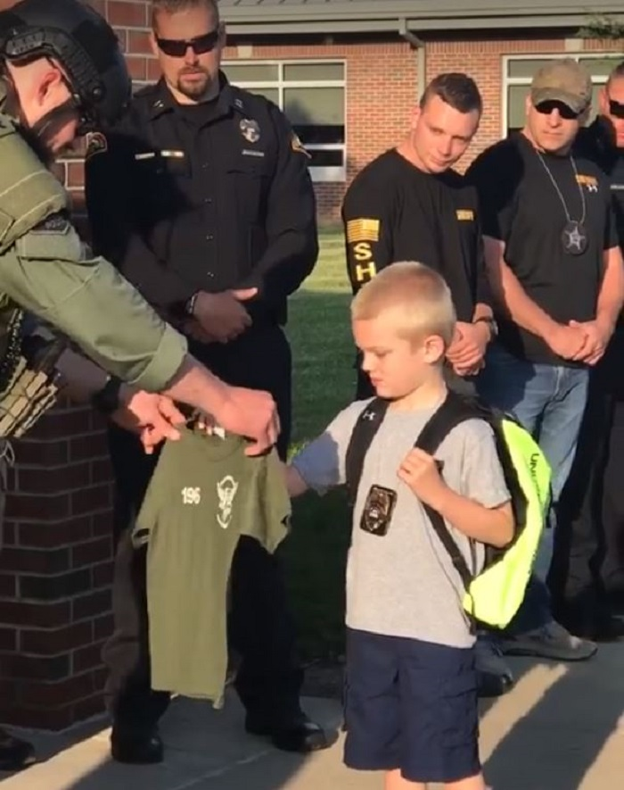 son of killed officer escorted by 70 officers