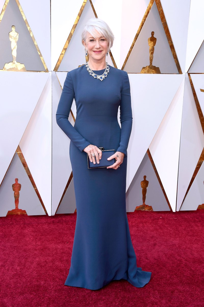 Helen Mirren In a deep blue long sleeved column gown.