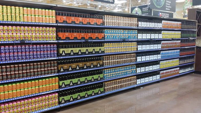 perfectly organized soda bottles at a grocery store