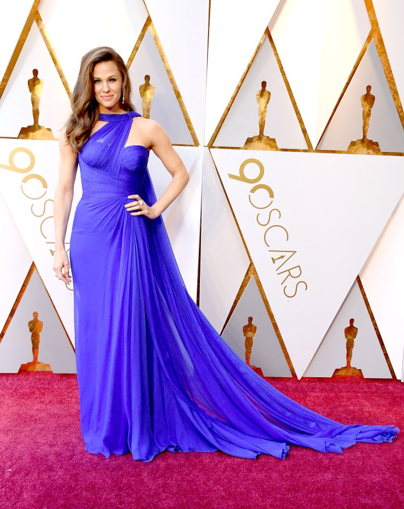 Jennifer Garner In a one-shouldered bright royal purple gown by Atelier Versace with a gathered waist and cape-like train.